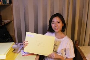 Jessie Jeong-yeon putting books and letters & mailing the envelopes