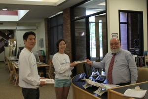 Jung-yeon and Dong-ho donated the book to Williston school's library.