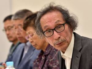 Haruki Wada, historian and professor emeritus of the University of Tokyo, speaks before the press with other Japanese historians in Tokyo onMonday. Japanese academics urged Prime Minister Shinzo Abe to renew apologies over the country's imperialist past and offer compensation to victims of its wartime brothel system, the latest in a line of interventions from scholars.